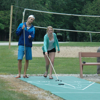 People playing outdoor shuffleboard