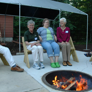 People sitting around a fire