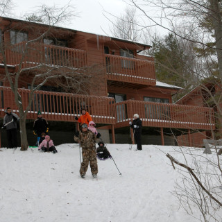 People sledding and skiing in the snow