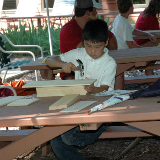 A child working on a carpentry project