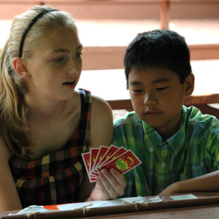 Children playing a card game
