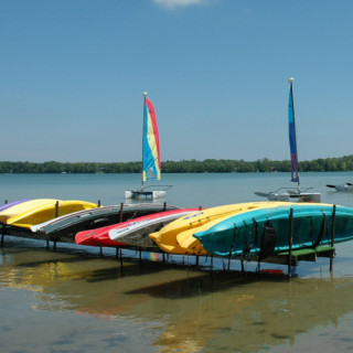 Kayaks and boats anchored on the lake